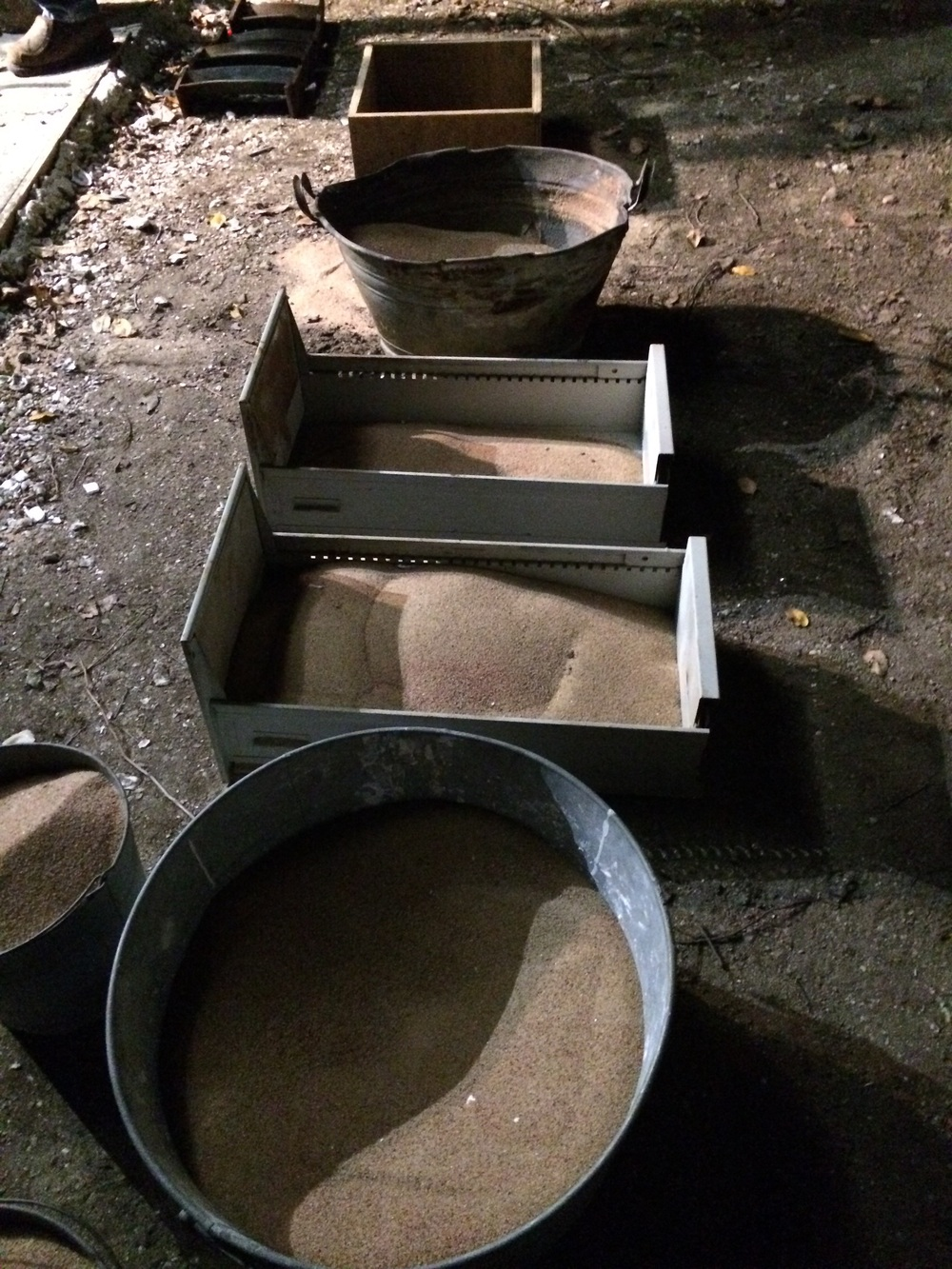 Buckets of sand that will hold the shells when we pour in the bronze.