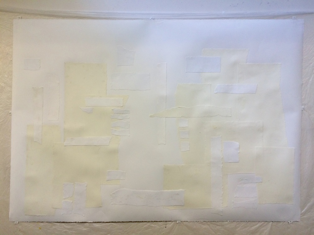 Collaging the paper with more paper before I start drawing. I am using two different colors of white.