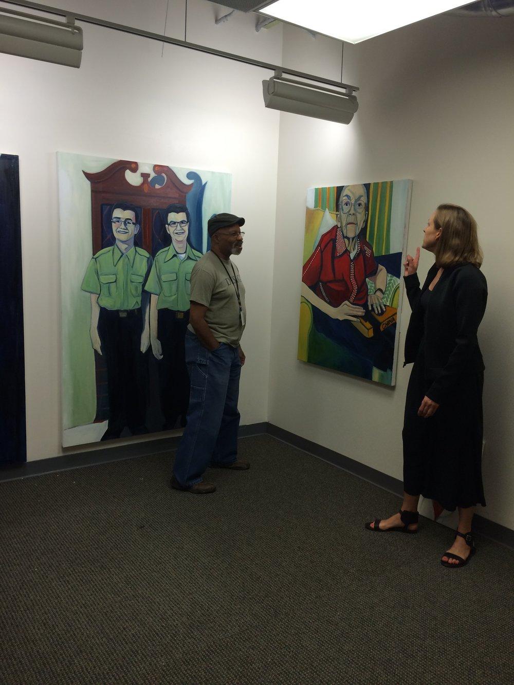 Sarah showing Romeo her work