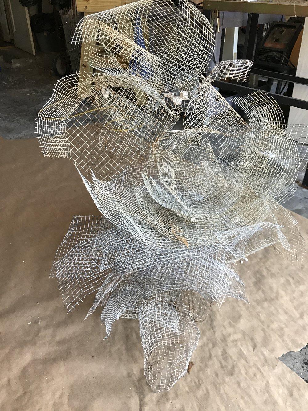 Chicken wire pigeon left in my garage. - basically it sculpt it's self.