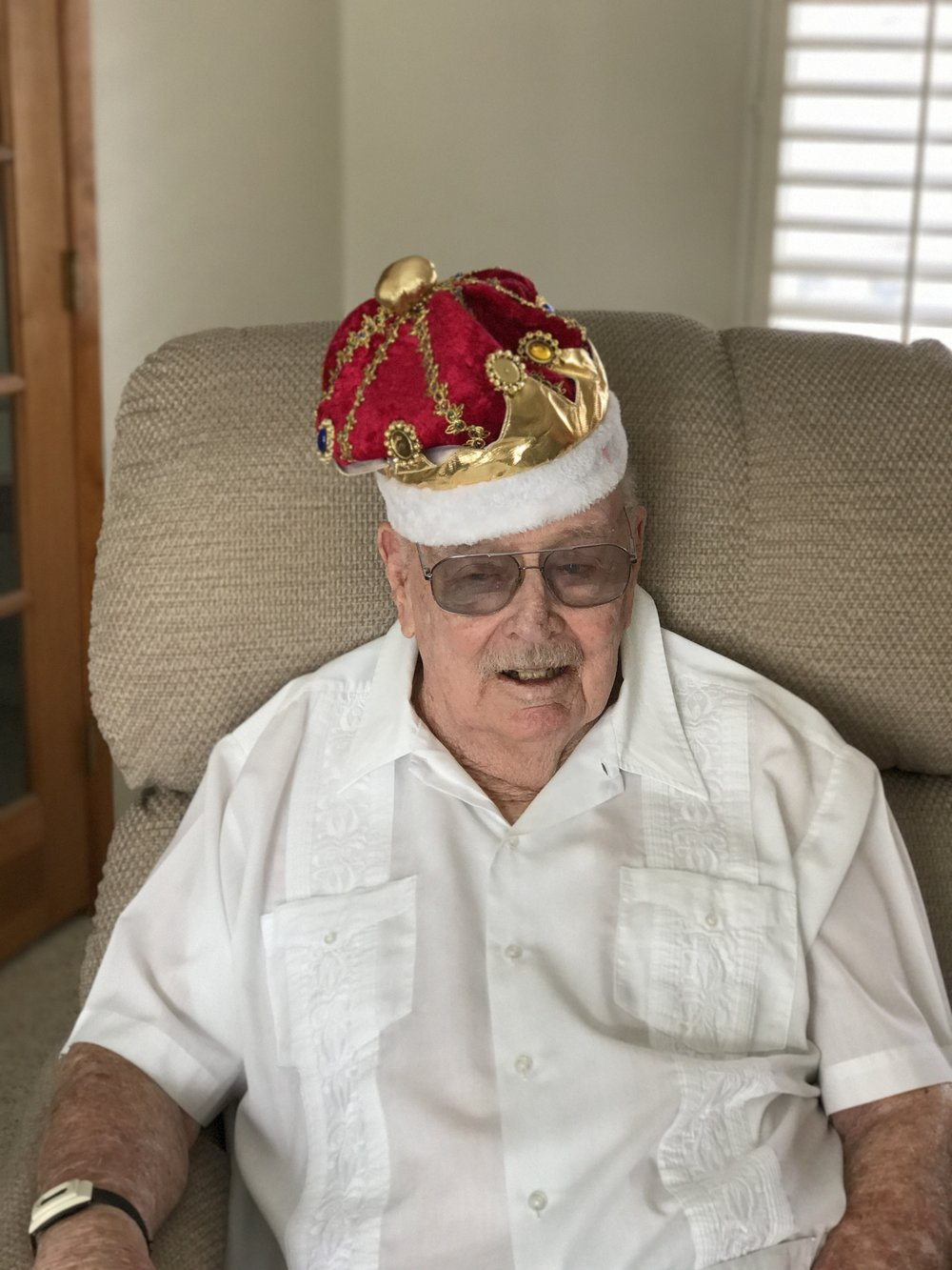 My Dad wearing his 89th birthday party  crown.