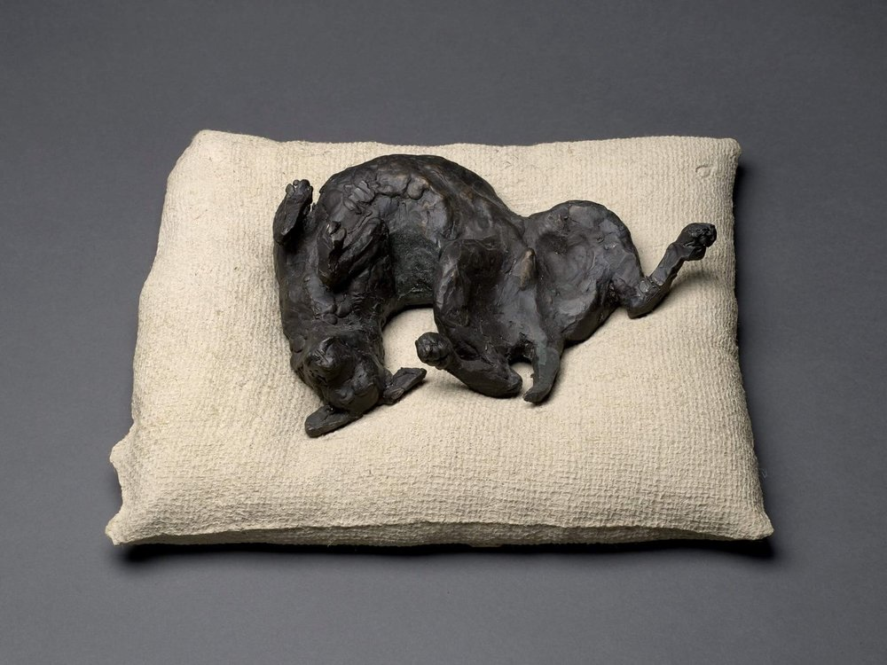 "HAPPY DOG - on bed 4"" X 8"" X 11"" bronze and concrete photo by Will Michele"