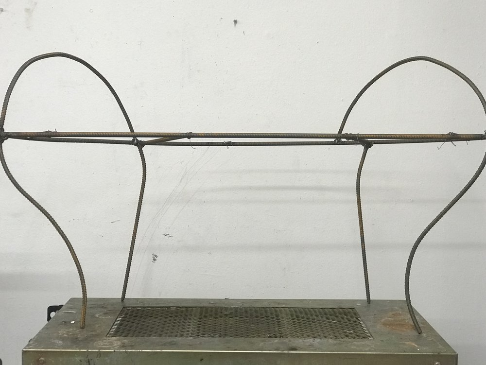 Four legs and two arm rest are welded to the seat.