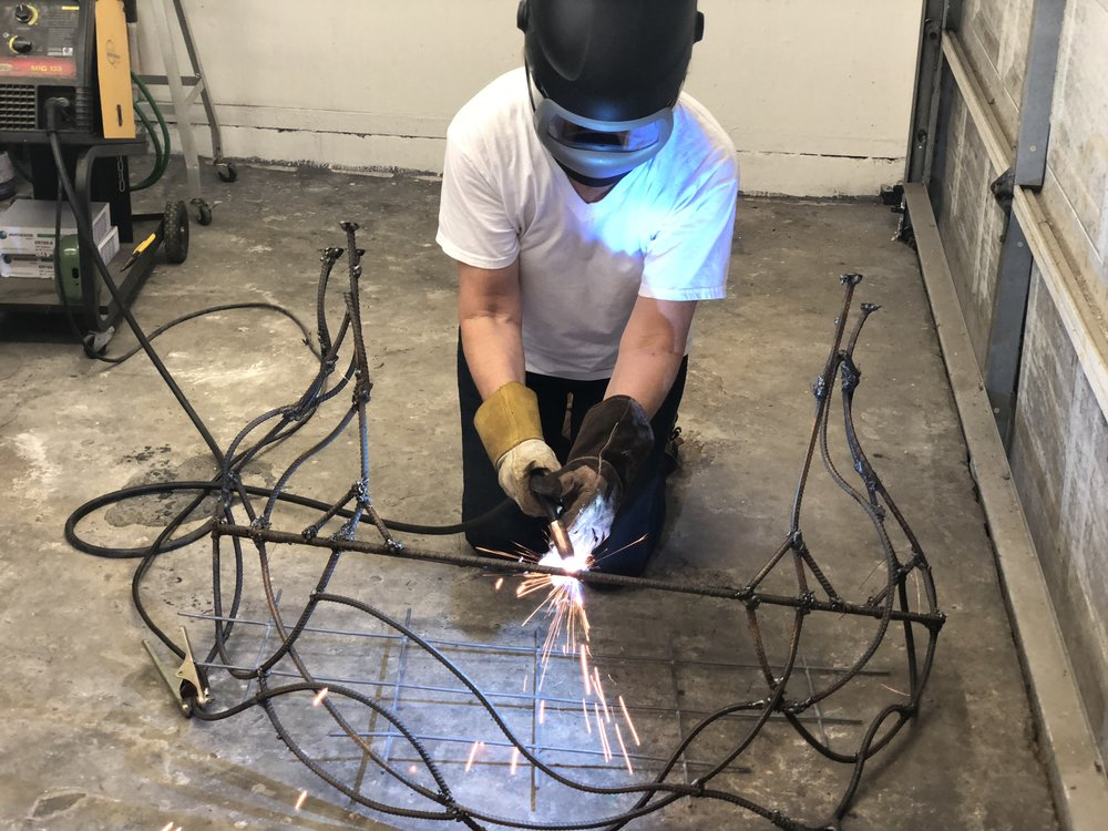 I have decide to double up on the front piece of rebar. Above I am tacking it to the first piece of rebar. (Thank you Sage for taking the pic.)