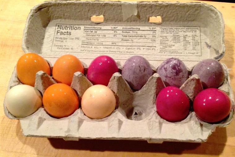 Yellow onion skin produced the orange, beets made magenta, and blueberries the variegated purple. On the end, one faintly green egg was from parsley, and the pale yellowish one was from cumin.