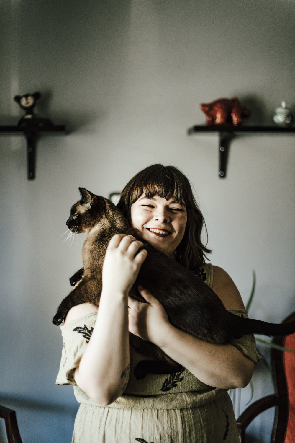 Photograph of the artist with her cat, Max by  Juliana Noelle Photography .