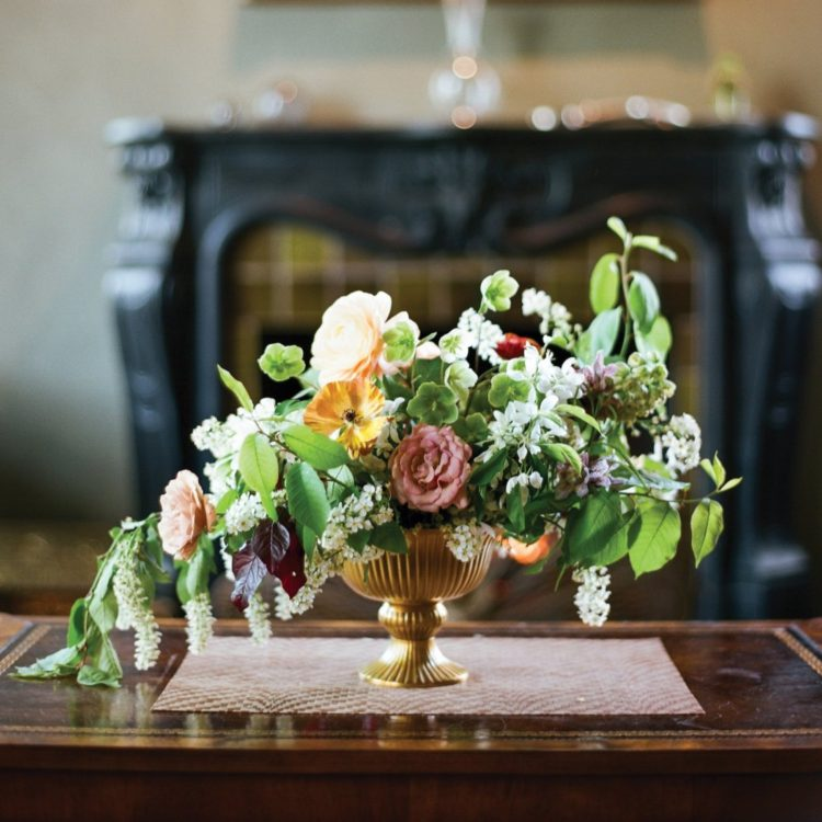 Elegant floral arrangements prepared by Fox punctuate the tables.