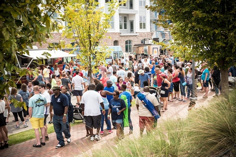 Locals swarm the street adjacent to the Park for Trucks by the Tracks, an annual food truck event and fundraiser for  Railroad Park . Image: Railroad Park Foundation