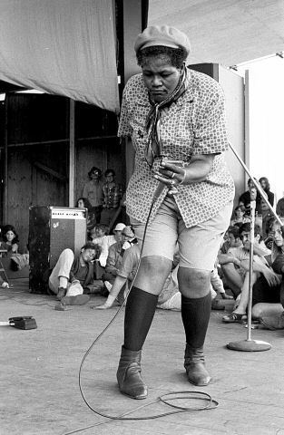"Known to test the boundaries of gender, Willie Mae ""Big Mama"" Thornton would often perform in men's clothing. Here, she's pictured swooning a crowd at the Newport Folk Festival. Image: Joe Sia"