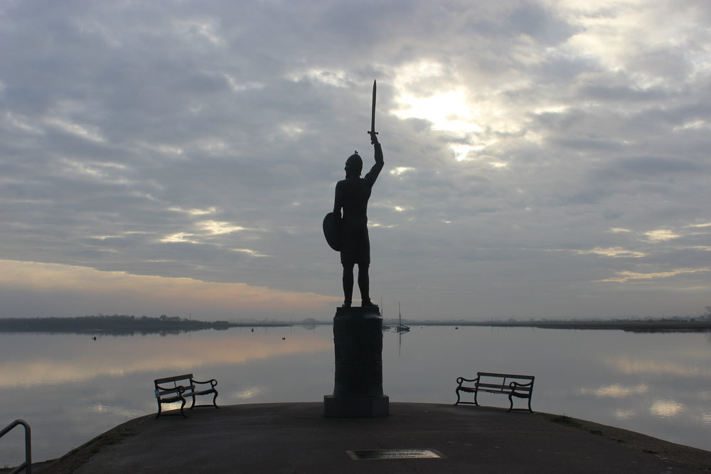 The modern statue of Byrhtnoth, looking down towards the site of the battle