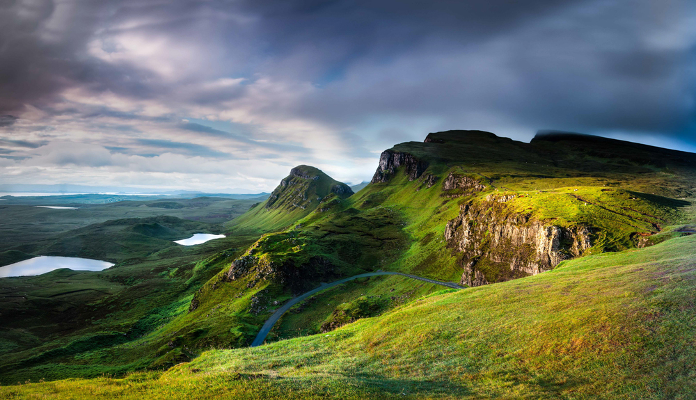 View from the Quiraing over the wild landscape of Trotternish to The Skye Blue Gallery at Ellishadder seen here on the horizon.