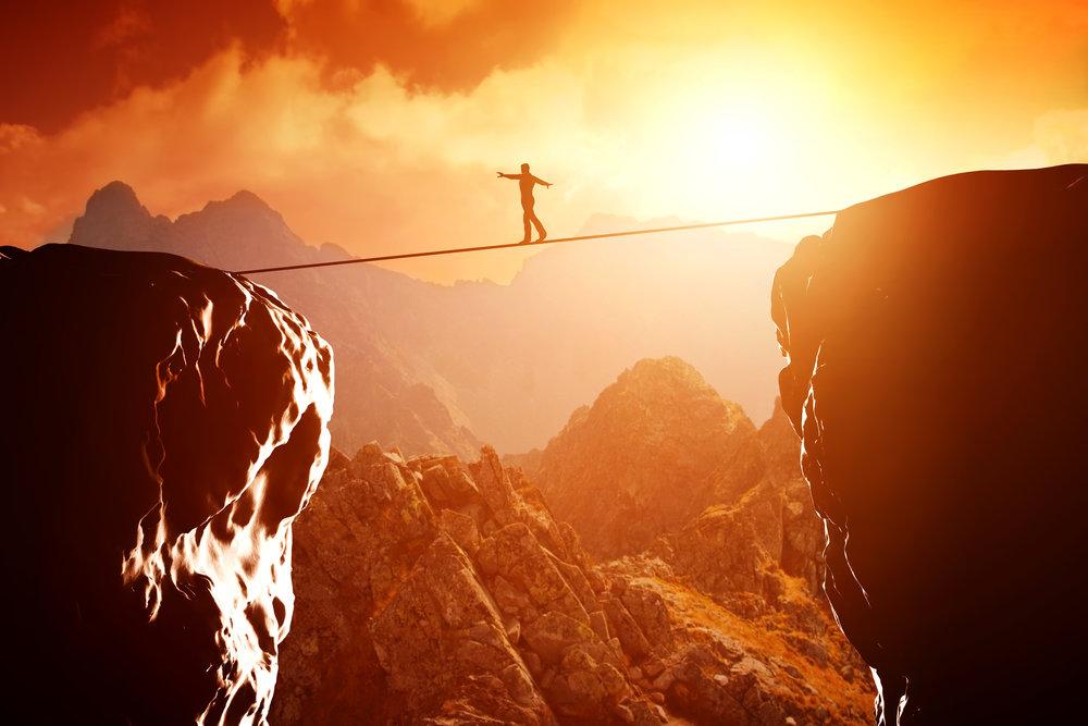Man walking tight rope.jpg