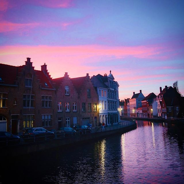 magical sunset on the walk home from dinner @pomperlut in #bruges. fell in love with the little city with its quiet streets and hidden gems