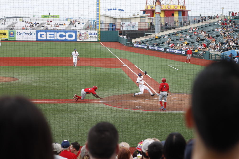A Williamsport Crosscutter slides into home plate against the Brooklyn Cyclones.