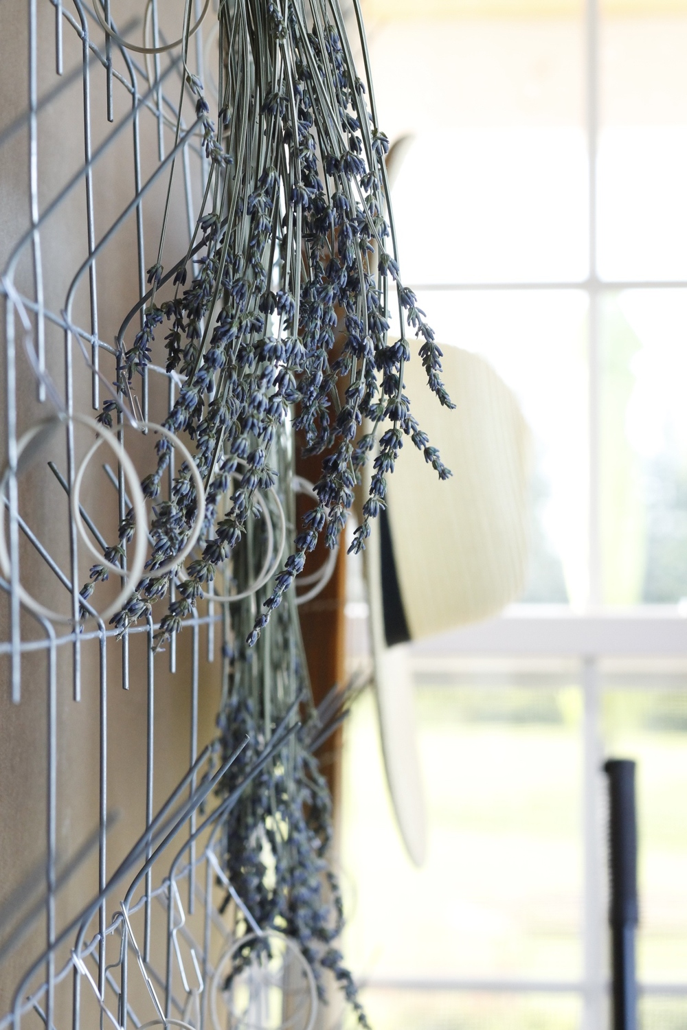 Lavender drying on the rack. Next to a floppy hat. Because what else would you wear on a Lavender Farm.