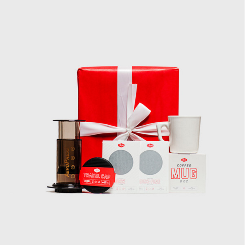 AEROPRESS BUNDLE: $60 PERFECT FOR: The coffee lover in your life. Kit includes an AeroPress coffee maker, coffee filters, and a mug.  Able Brewing