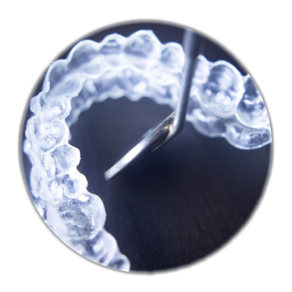 2-It aligns your teeth without using metal braces. You still can eat without it, then floss normally. -