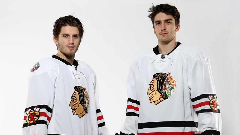 A pair of fans model the Winter Classic jerseys they bought two years ago. Source