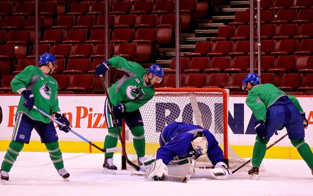 Canucks players look for a rebound from Jacob Markstrom after a weak shot by Simon Porter. Source