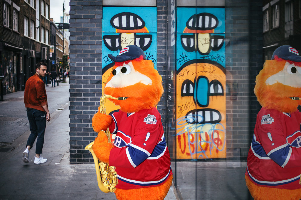 "Youppi! plays ""Yakety Sax"" for passersby. It's what he refers to as a 'fan favourite'. Image source:  Simon Law  &  adil113"