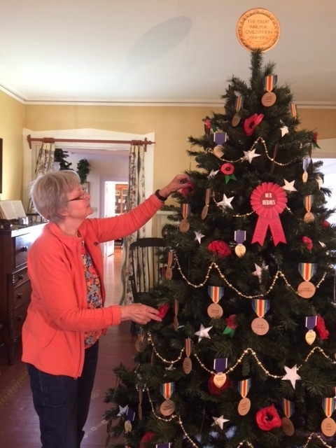 Jean Jankowski puts the finishing touches on the WWI tree.