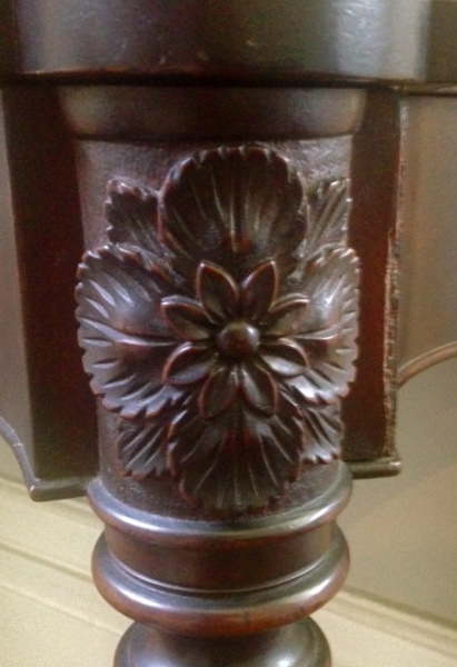 Carved flower and foliage, a signature of the McIntire workshop.