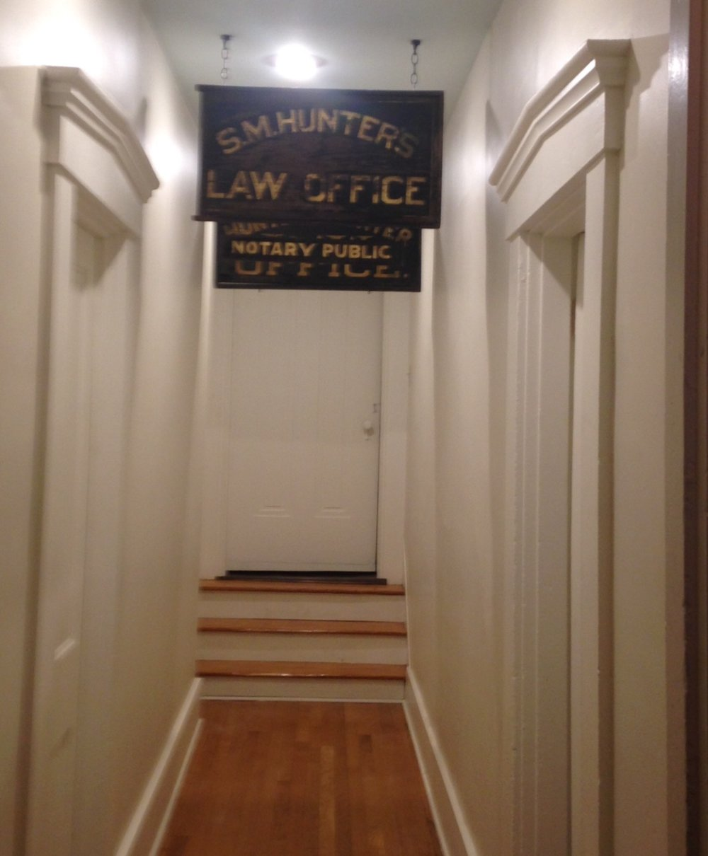 The black and gold leaf signs were used to advertise the law office of Robbins Hunter, Sr. and his father Samuel Hunter, in Newark, both lawyers and judges.
