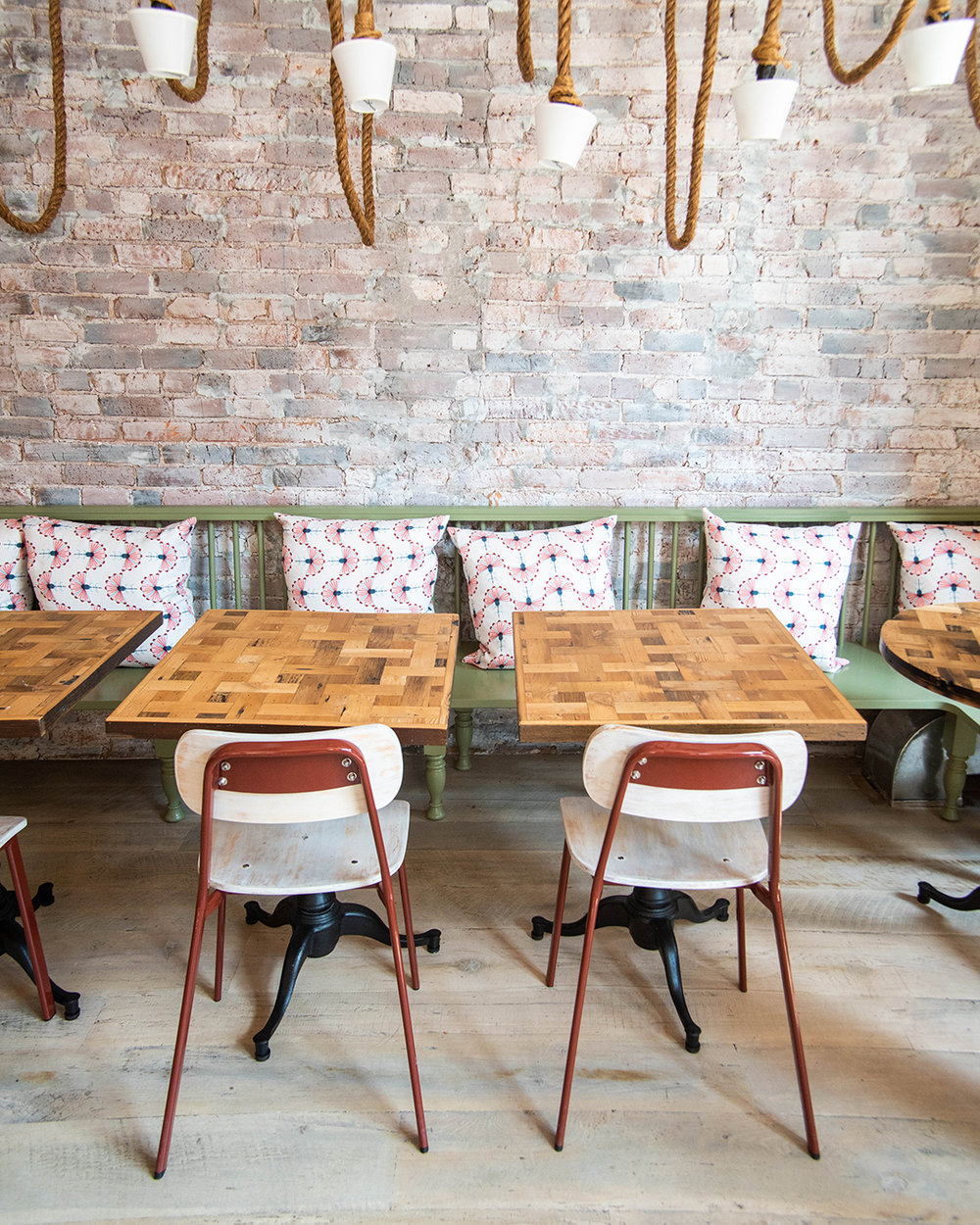 Reclaimed Basketweave Tables and White-Washed Reclaimed Flooring at Rosemary's Pizza NYC