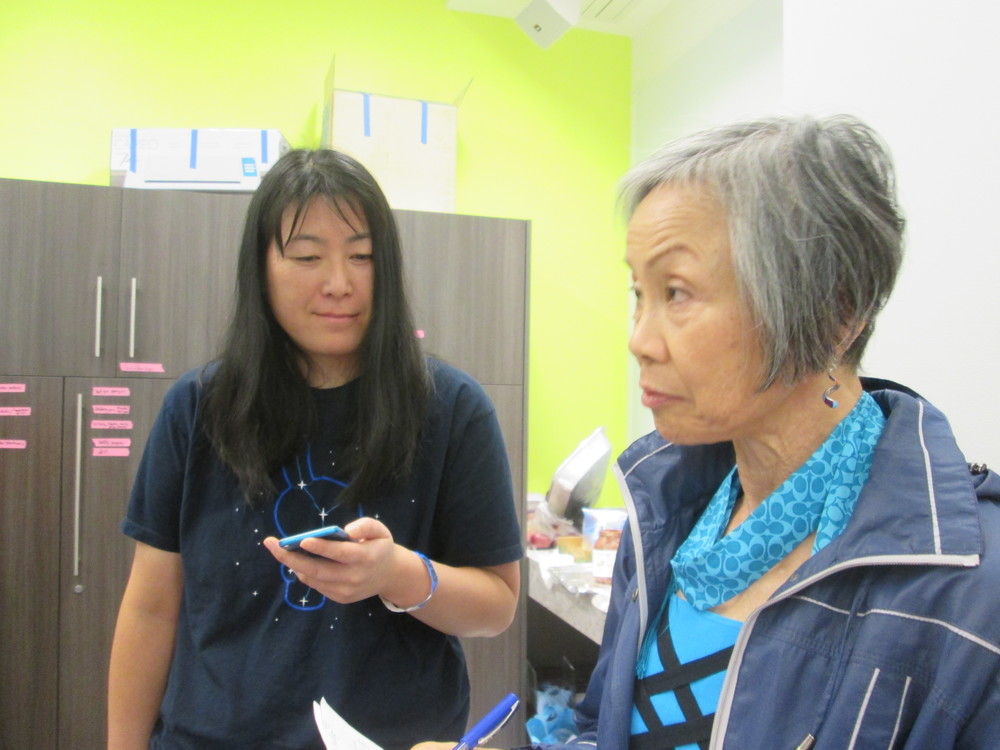 Mentors discussing best first-time and best female hacker awards, Lily Lew Project_Chemistry Founder, Barbara Jue Peace Corps, Technovation Moldova