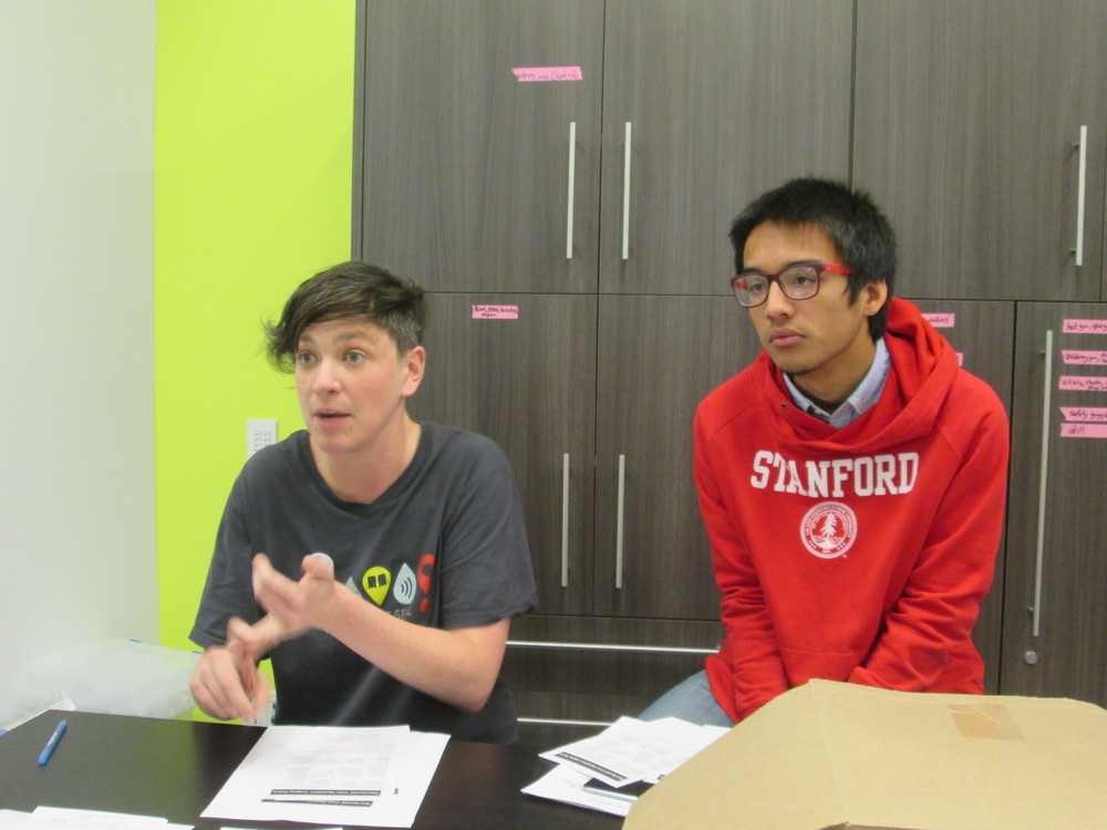 TeenTechSF Civic Hackathon judges deliberate: So many great ideas, so little time... The Mix teen librarian Mary Abler and TTSF Founder Marc Robert Wong