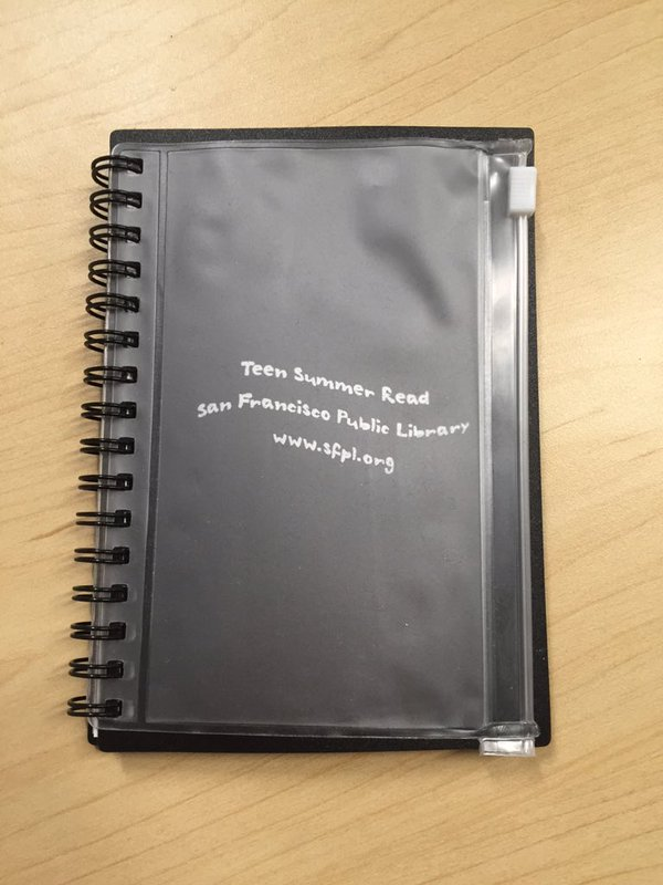 Hackathon participants received notebooks from the Friends of SFPL