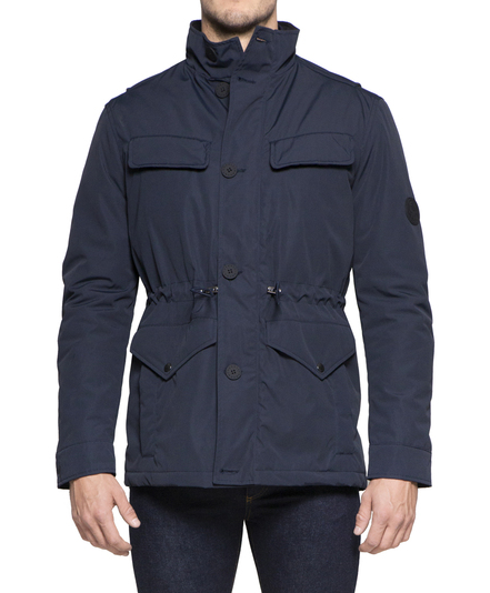 JONES Navy Men's Winter Field Jacket £238.00 Understated technical winter field jacket with minimum branding and decoration for a sleek stealthy look. Follows classic field jacket design codes updated for a modern urban winter. Distinctive shoulder/back design with action back pleating detail suggests military look. Rubberised front panel buttons. Elasticated drawstring waistband for additional insulation.  Comfortable fit for ease of use in smart and casual wear.  Technical fabric which is wind and water resistant, with internal wadding and premium fleece-like lining to keep you insulated and warm. Also availalble in Black.   Click here to buy.
