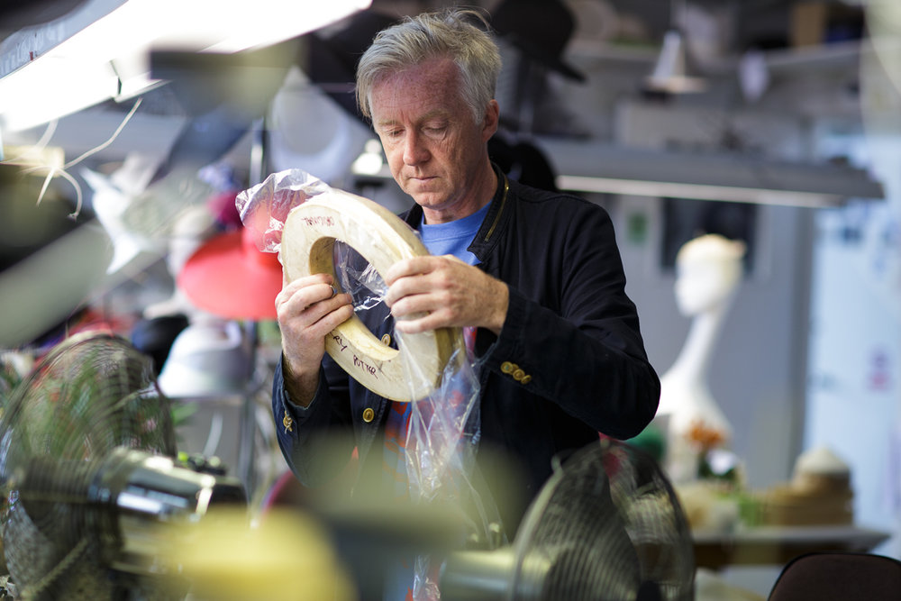 *PICTURE CAPTION:  Behind the scenes with Philip Treacy at Warner Bros. Studio Tour London, adding the finishing touches to the Beauxbatons hat to be showcased in the new feature, Wizarding Wardrobes