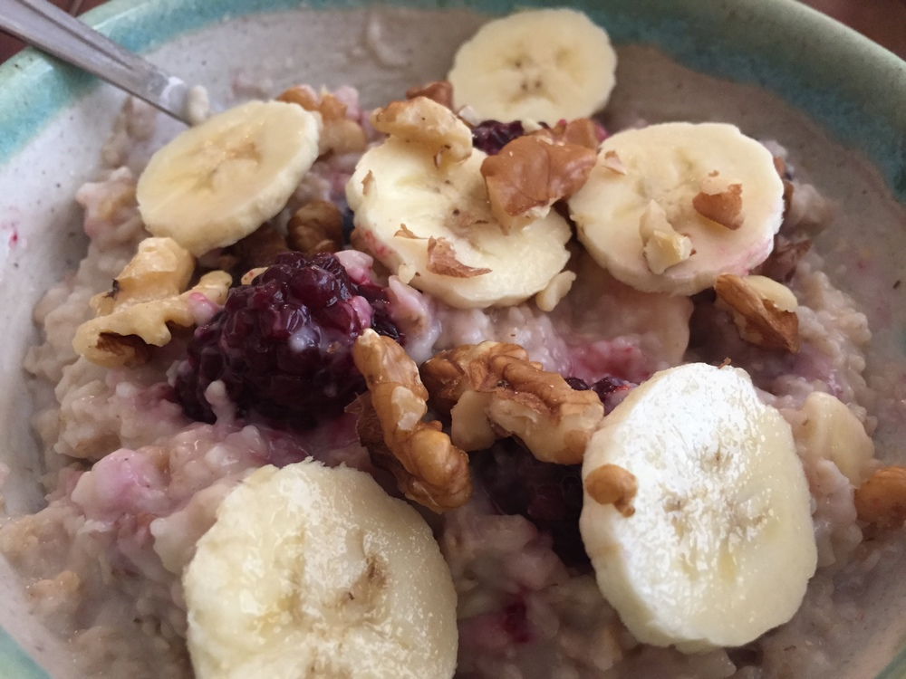 Overnight Oats with sliced bananas, organic blueberries and walnuts