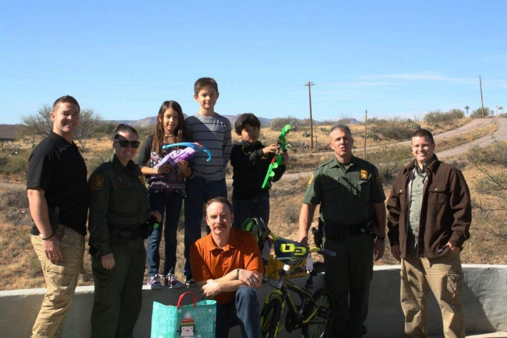 Tucson Agents hand delivering the Christmas presents.