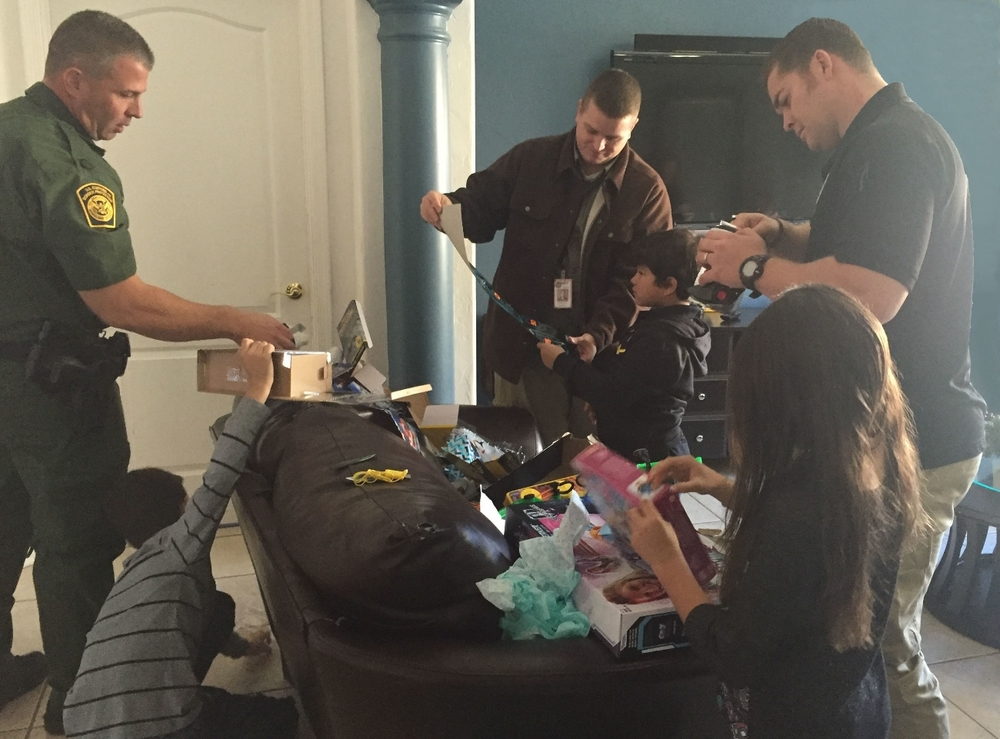 Tucson Agents opening presents with the kids.