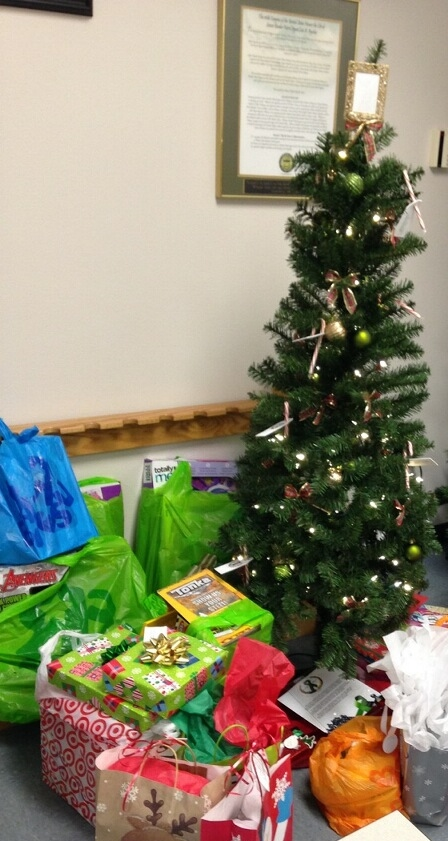 The process starts here where the Agents give gifts by placing them under the tree.