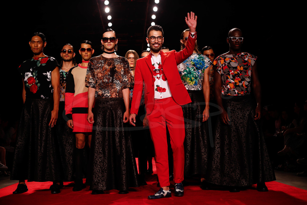 David Alfonso waving at crowd with models.