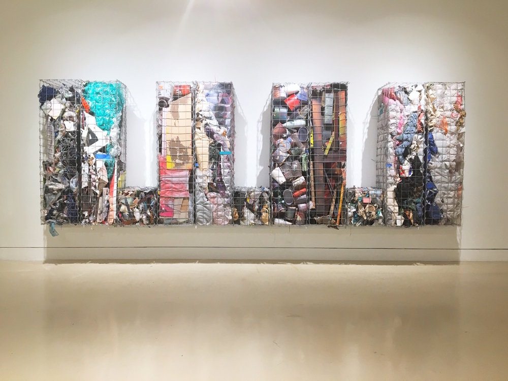 IAIN MUIRHEAD   18161:18172  , 2014-2018. Gabion baskets, zip ties, aggregate studio material. 60 x 174 x 16 inches. Installation view Torrance Art Museum.