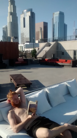 The building had its own rooftop pool, which was very relaxing. We hung out up there all Friday afternoon. (Note on Andy's hair: Yes, it is in a man bun. He loves it like that, and since we were celebrating his birthday, he argued he should get to wear it like that. I grudgingly relented.)