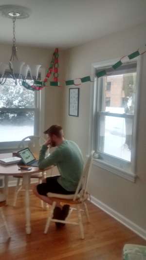 Andy is working while enjoying the snow and the paper chains.