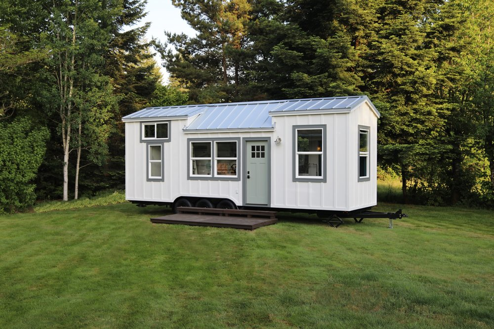 Seabrook - SEABROOK - $71,00028' x 8.5' - 238 sqft (main level) + 72 sqft (loft)= 310 sqft.Inspired by my love for the town of Seabrook, Washington. Notable features include a downstairs murphy bed, wideplank oak hardwood and a large loft.