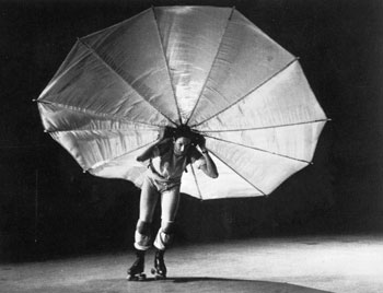 "Rauchenberg performing in his own performance called ""Pelican"" (1963) after working with the Judson Dance Theater."