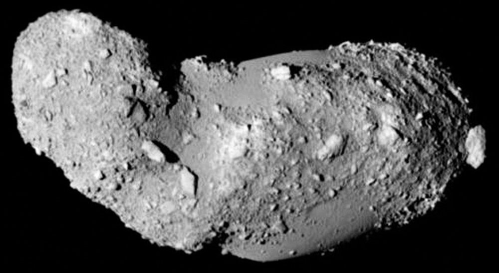 Image of asteroid Itokawa (Credit: JAXA). Notice that the surface has many large boulders. The one on the right seems to be just sitting there.