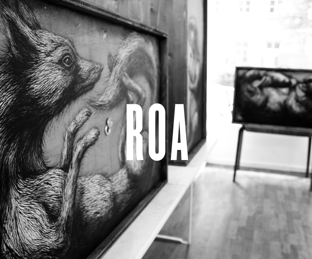 Belgian artist ROA works on a large scale, painting black.and-white animal images on abondoned factories and urban walls. Created using simple means-typically only black and white house paint and black and white spray paint- ROA´s street paintings reflect the aesthetic of naturalistic drawings more than a graffiti sensibility, even when painted on hundred-foot-walls. ROA typically chooses animals based on the mural´s particular location, depicting those that are native to the area; his birds, mice, rats, and barnyard animals often find themselves piled atop one another or draped across unusual features of the found surfaces on which he paints. ROA has travelled extensively in recent years, creating for example works in the streets of New York, Moscow, Madrid, London, Berlin, Los Angeles, Cologne, Stavenger, Zaragoza.