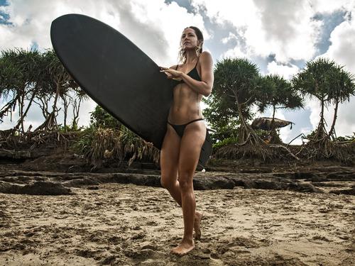 leah-simmons-surfing.jpg