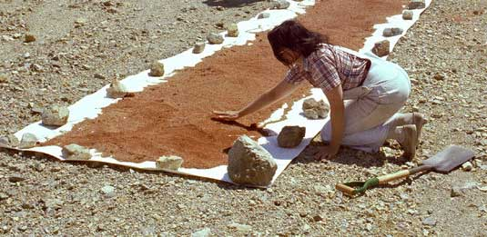 """Figure 4. LINK, R. 1977.Michelle Stuart working on one of her """"Color/Time/Landform Transformations"""" at a quarry."""