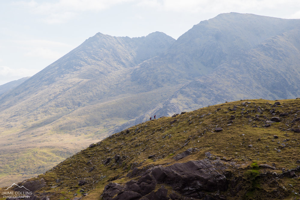 Two lone hikers making their way through the Reeks