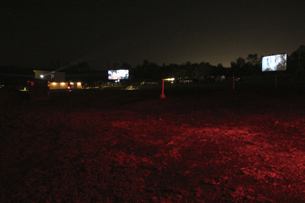 At the drive in, photo by  Stu Sherman . This photo has everything: stars and the light of the projection house.