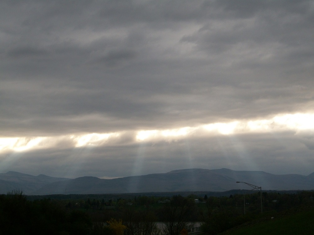 A gorgeous recent sunset, where the clouds came together over the Catskills like a zipper, sunlight spilling through.